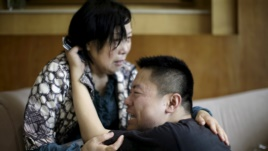 familjaret e te mbyturve ne kine